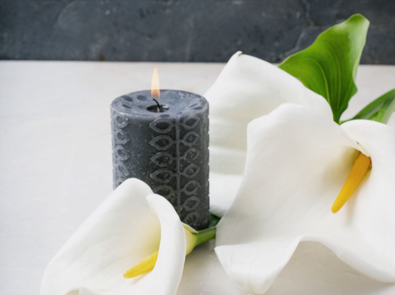 candle and lilies